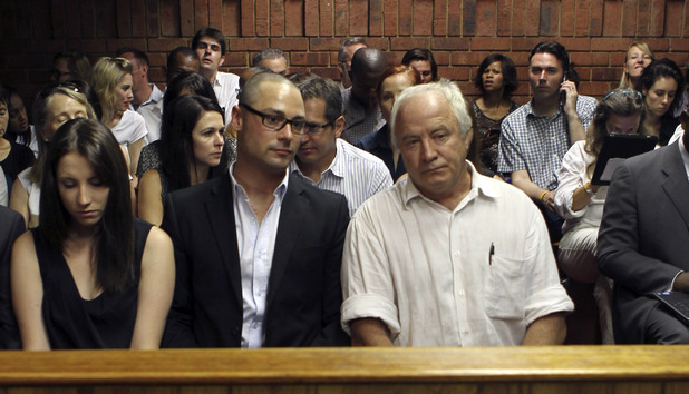 The family of Oscar Pistorius, sister Aimee, brother Carl and father Henke Pistorius, at the magistrate court in Pretoria