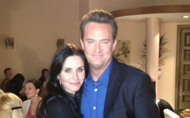 Courteney Cox and Matthew Perry on set of Go On.