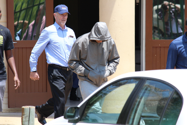 Oscar Pistorius leaves the Boshkop Police Station following his arrest