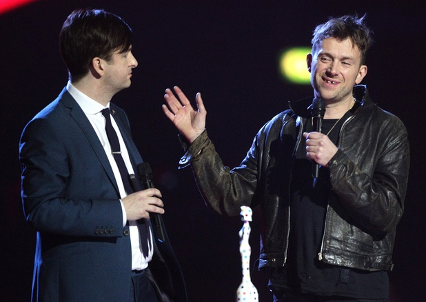 Ben Knowles (left) from War Child and Damon Albarn (right) collect the Special Award on behalf of War Child during the 2013 Brit Awards at the O2 Arena, London.