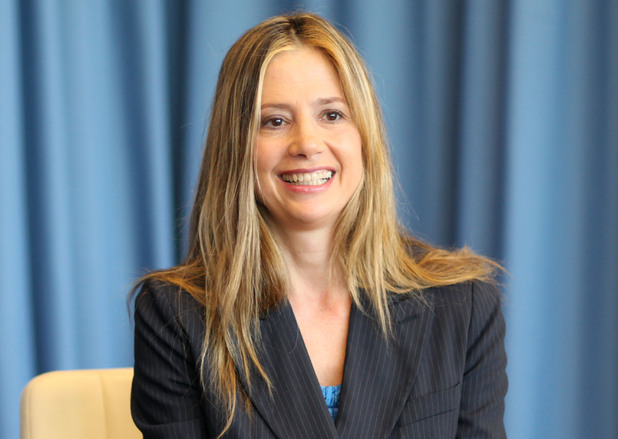 Mira Sorvino with UNODC executive director Yury Fedotv - February 8, 2013