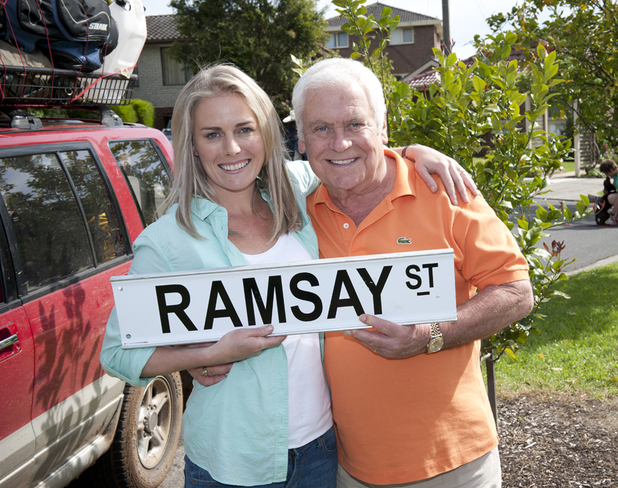 Kate Kendall who plays Lauren Turner and Tom Oliver who plays Lou Carpenter in Aussie soap Neighbours