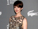The 30-year-old Les Miserables star stuns in a shimmering gold Gucci dress.