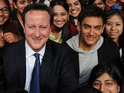 Khan and Cameron discuss equal opportunities with students at a girls' college.