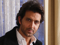 The director says his son Hrithik Roshan looks and performs like a superhero.