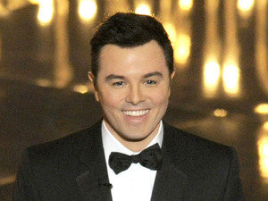 Seth MacFarlane on stage at the 2013 Oscars