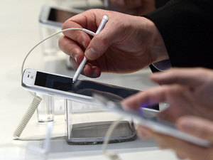 Visitors are seen with the new Samsung Galaxy Note 8 at the Mobile World Congress 2013 trade show in Barcelona