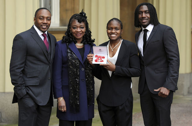 Nicola Adams with her uncle Robert Ottley, mother Denver and brother Kurtis at her MBE investiture
