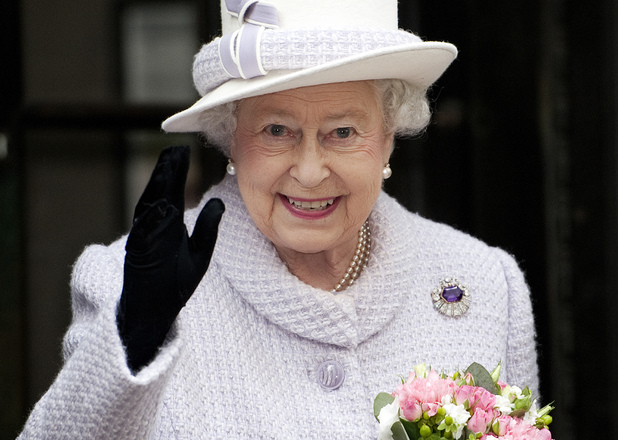 Queen Elizabeth II waves during her visit to the Bank of England in central London.