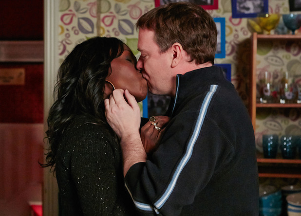 Ian and Denise share an emotional kiss.