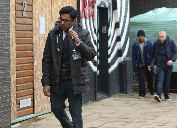 Tamwar is watched by the gang as he leaves the market.