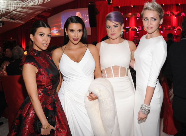 WEST HOLLYWOOD, CA - FEBRUARY 24: (L-R) TV Personalities Kourtney Kardashian, Kim Kardashian and Kelly Osbourne and actress/singer Miley Cyrus attend the 21st Annual Elton John AIDS Foundation Academy Awards Viewing Party at Pacific Design Center on February 24, 2013 in West Hollywood, California. (Photo by Jamie McCarthy/Getty Images for EJAF)