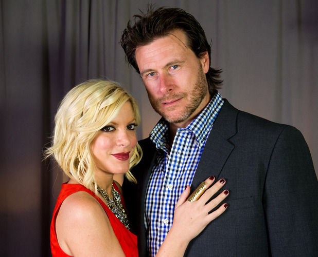 Tori Spelling and Dean McDermott pose for a portrait in New York, Monday, April 4, 2011.