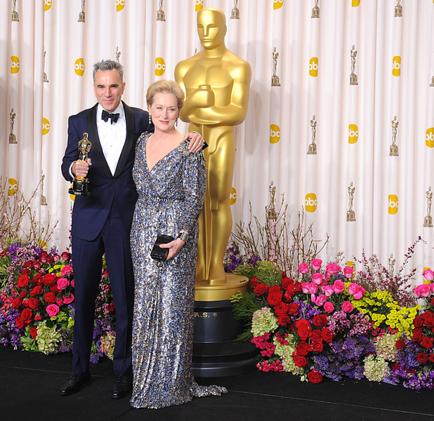 Daniel Day-Lewis with his 'Best Actor' Oscar, accompanied by Meryl Streep