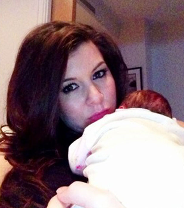 Imogen Thomas cuddles daughter Ariana Siena in picture dated 25 February