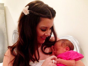 Imogen Thomas cradles daughter Ariana Siena in a Twitter picture from 4 March 2013