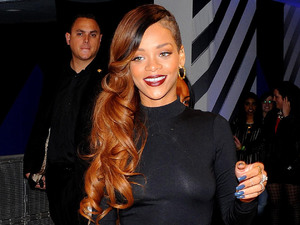 Rihanna makes an appearance at the River Island store in Oxford Street, London, to promote her new fashion line.