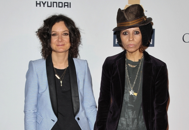 Sara Gilbert (in blue jacket) and Linda Perry (in black jacket and hat), Clive Davis pre-Grammy gala 2013