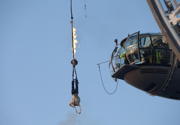 British daredevil Jonathan Goodwin dangling from London Eye