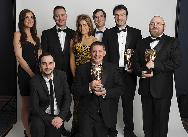 David Braben and Zoe Hardman pose with the TT Games team who won the Family BAFTA for 'LEGO Batman 2: DC Super Heroes' at the BAFTA Games Awards 2013