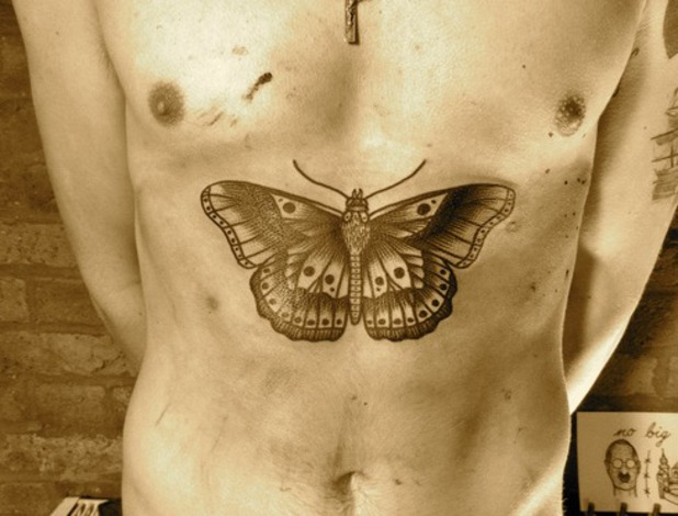 Harry Styles butterfly tattoo