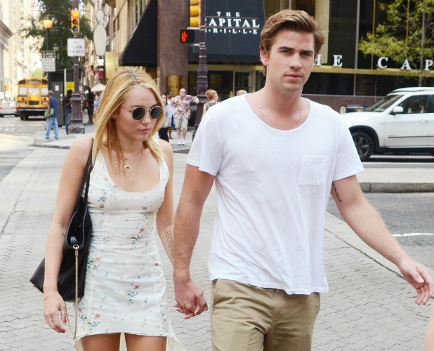 Miley Cyrus and her fiance Liam Hemsworth depart Capital Grille after having lunch Philadelphia, Pennsylvania - 18.07.12 Mandatory Credit: Hugh Dillon/WENN.com