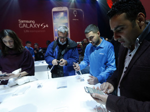 Samsung Galaxy S4 smartphone - guests try out the new handset at the firm's New York launch event