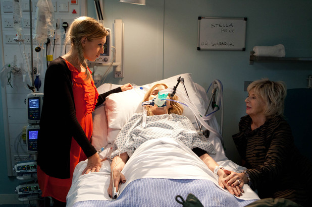 Eva and Gloria at Stella's bedside after the Rovers fire