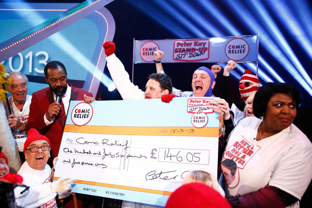 Peter Kay and fundraisers celebrate £146.05 raised from the comedian's 'Sit Down' challenge