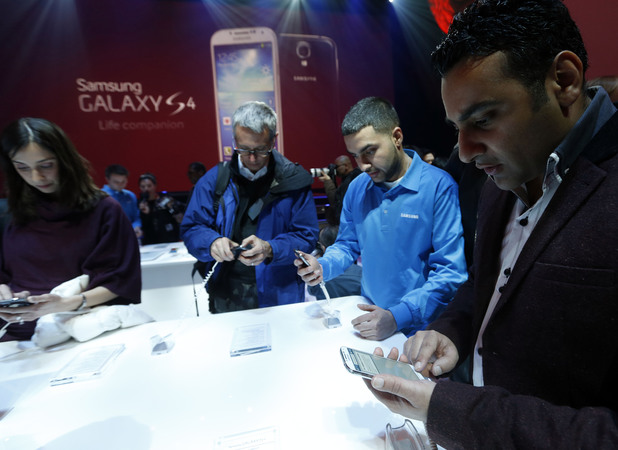 Guests try out the Samsung Galaxy S4