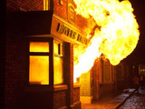 8085: An explosion sends flames throughout the Rovers as residents approach in a state of panic