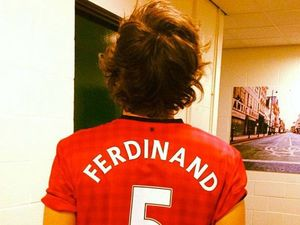 Harry Styles wears Rio Ferdinand's Manchester United shirt.