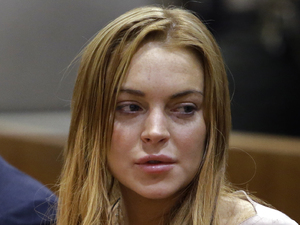 Lindsay Lohan with her lawyer Mark Heller at Los Angeles County Superior Court - March 18, 2013