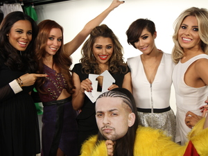 The Saturdays with their Official Charts Company number one award