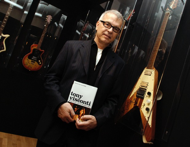 Legendary American music producer Tony Visconti poses next to a 1970 Hoyer Flying Arrow guitar, as played by Marc Bolan, during a signing session for his book 'Bowie, Bolan and the Brooklyn Boy', at Harrods in central London.