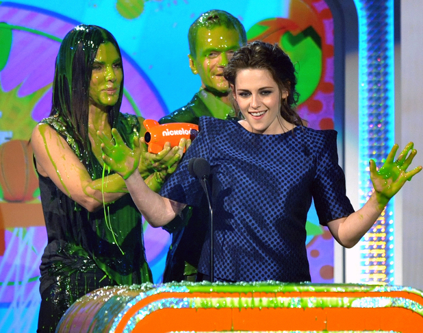 Kristen Stewart isn't bothered by a bit of slime as she collects her award.