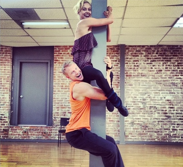 Sean Lowe and Peta Murgatroyd cling onto a pole during Dancing With The Stars rehearsals