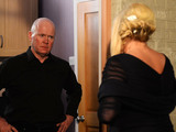 Phil answers the front door to Sharon.