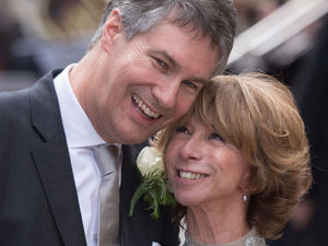 Newly weds Helen Worth and Trevor Dawson step out of the church.