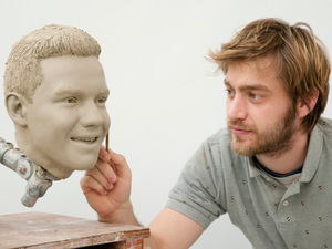 Madame Tussauds Sculptor Alex Carlisle works on the clay head for One Direction's Liam Payne