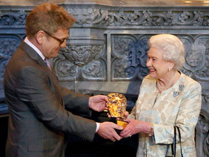Queen Elizabeth II receives an honorary Bafta from Kenneth Branagh in recognition of a lifetime's support of British Film and Television - and for being 'the most memorable Bond girl yet' at Windsor Castle