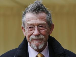 John Hurt arrives for a reception for the British Film Industry held by Britain's Queen Elizabeth II and The Duke of Edinburgh at Windsor Castle