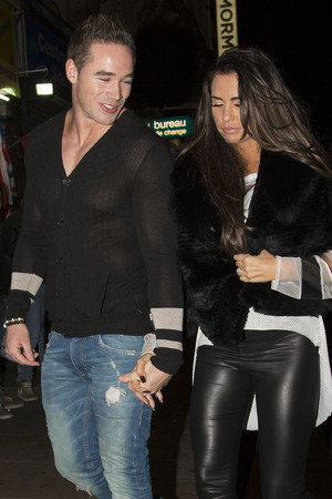 Katie Price and husband Kieran Hayler leaving Cafe De Paris with friends after a night out.