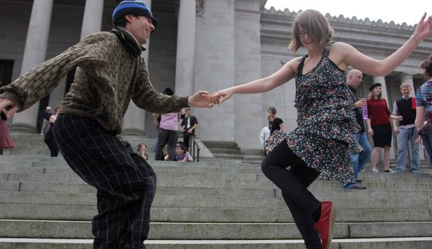 Melissa Petersen and Kevin Buster dance on the steps of the Capitol in Olympia, Washington in protest of a state tax on dance venues