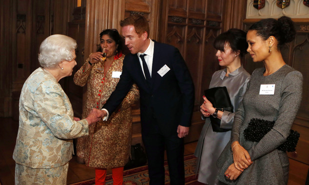 Queen Elizabeth II meets Damian Lewis at the reception for the British Film Industry held by Britain's Queen Elizabeth II and The Duke of Edinburgh at Windsor Castle