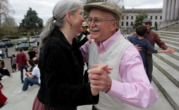 Lauri Miller and Don Morgan dance on the steps of the Capitol in Olympia, Washington in protest of a state tax on dance venues