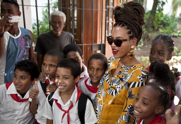 Beyonce poses for photos with school children in Old Havana in Cuba where they are celebrating their fifth wedding anniversary