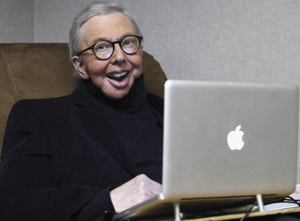 Pulitzer Prize-winning movie critic Roger Ebert works in his office at the WTTW-TV studios in Chicago