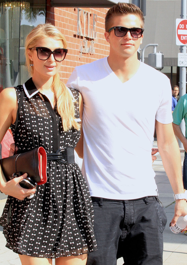 Paris Hilton and her boyfriend River Viiperi walking on Bedford Drive