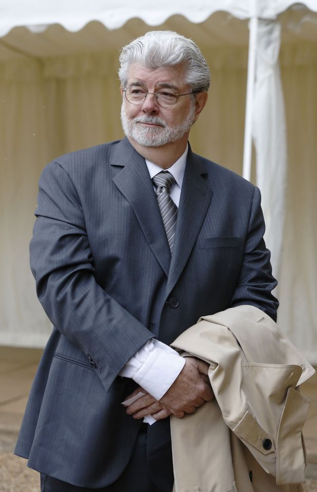 George Lucas arrives for a reception for the British Film Industry held by Britain's Queen Elizabeth II and The Duke of Edinburgh at Windsor Castle